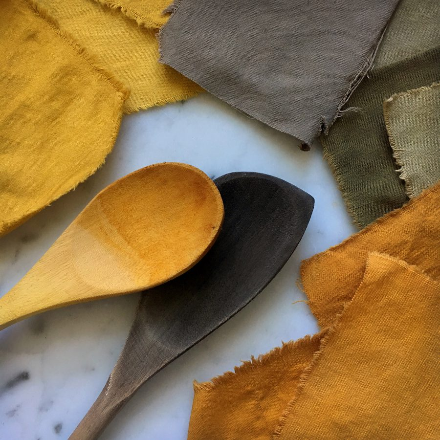 Wooden spoons dyed yellow and deep brown from use