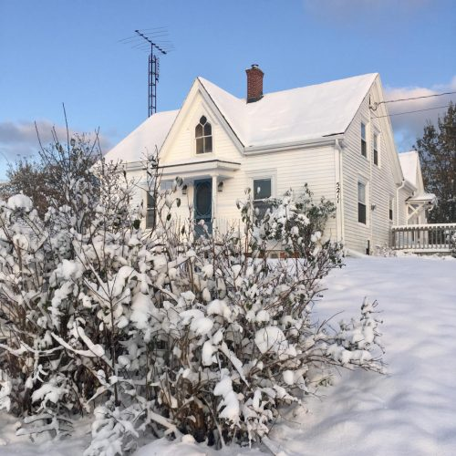 Gothic revival farmhouse in the snow