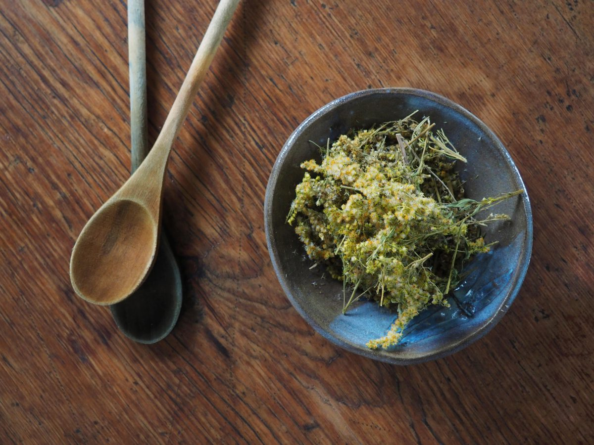 Goldenrod natural plant dye in a bowl