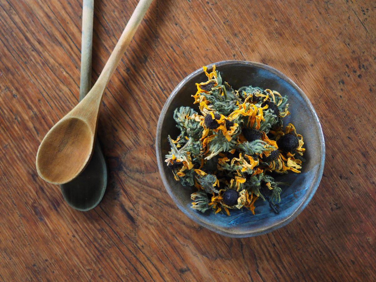 Rudbeckia natural plant dye in a bowl