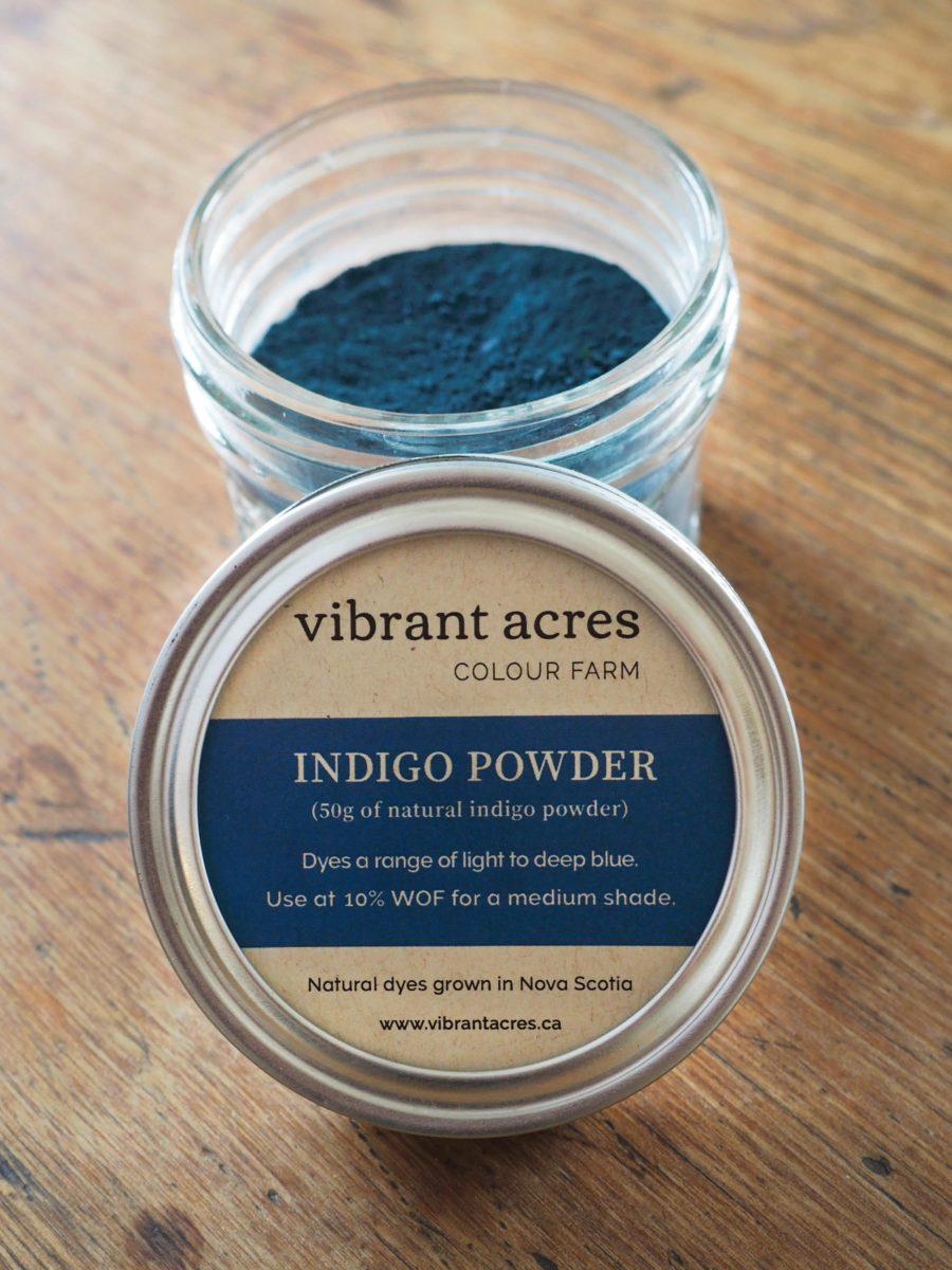 Jar of indigo powder with Vibrant Acres label